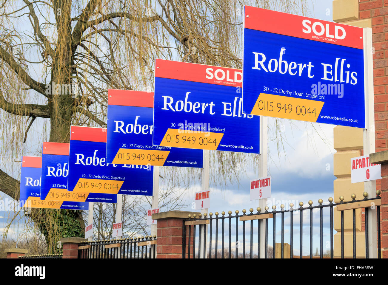 A row of estate agent house  'sold' signs. In Awsworth, Nottinghamshire, England. - Stock Image