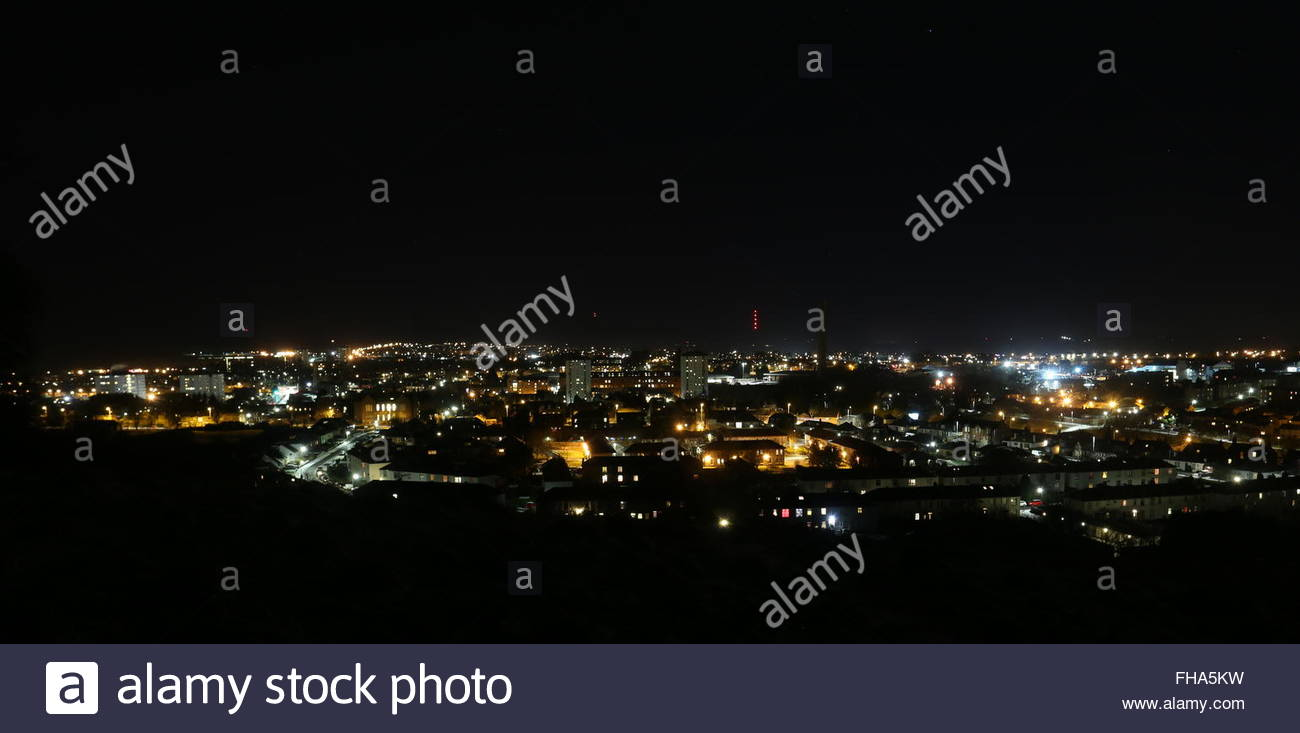 Council housing and Cox's stack chimney by night Lochee Dundee Scotland  January 2016 - Stock Image