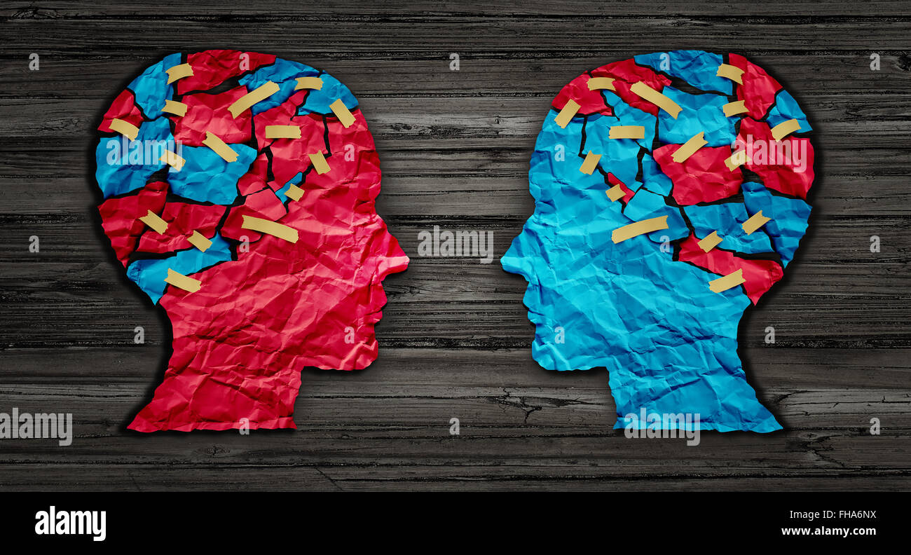 Thinking exchange and idea partnership business communication concept as a red and blue human head cut from crumpled - Stock Image