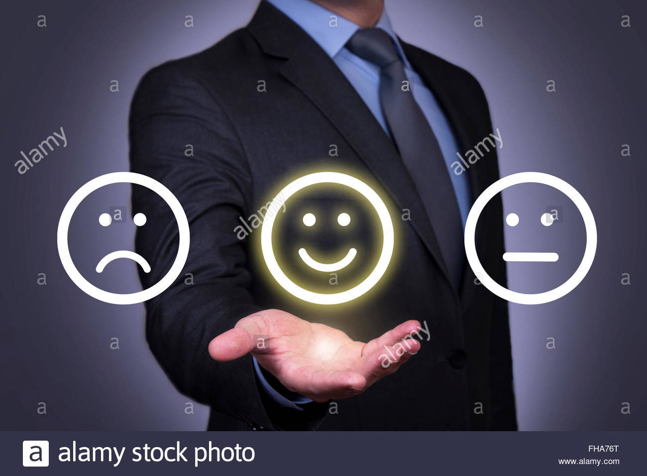 Happy Face on Human Hand - Stock Image