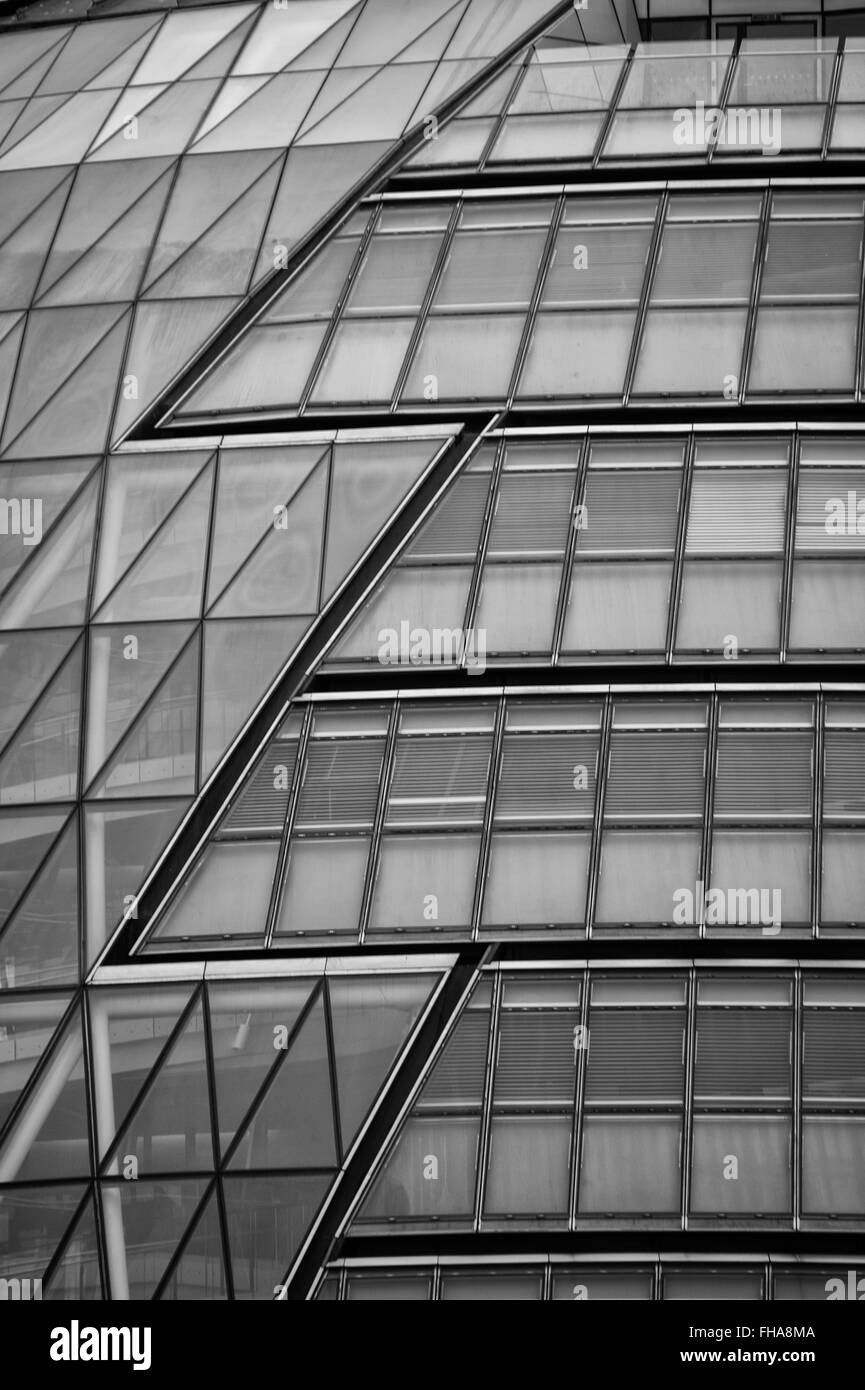 Geometric shapes on glass facade of London City Hall - Stock Image