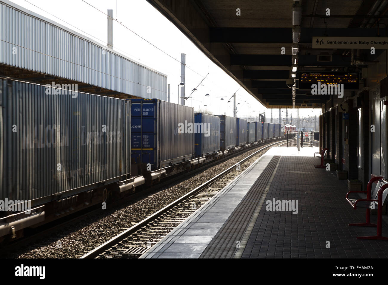 DB Schenker Container Freight Train at Warrington Bank Quay hauled by Electric Locomotives Stock Photo
