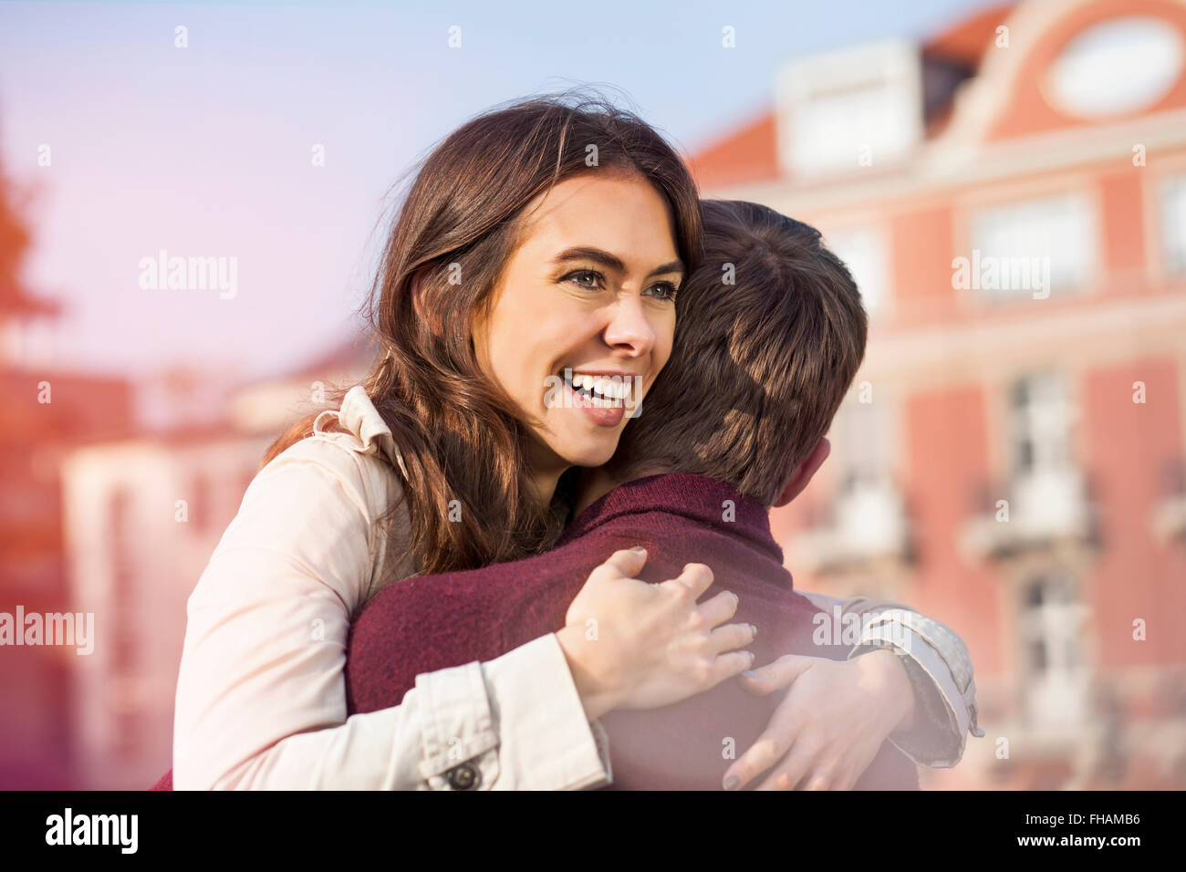 Germany, Berlin, happy young couple hugging Stock Photo