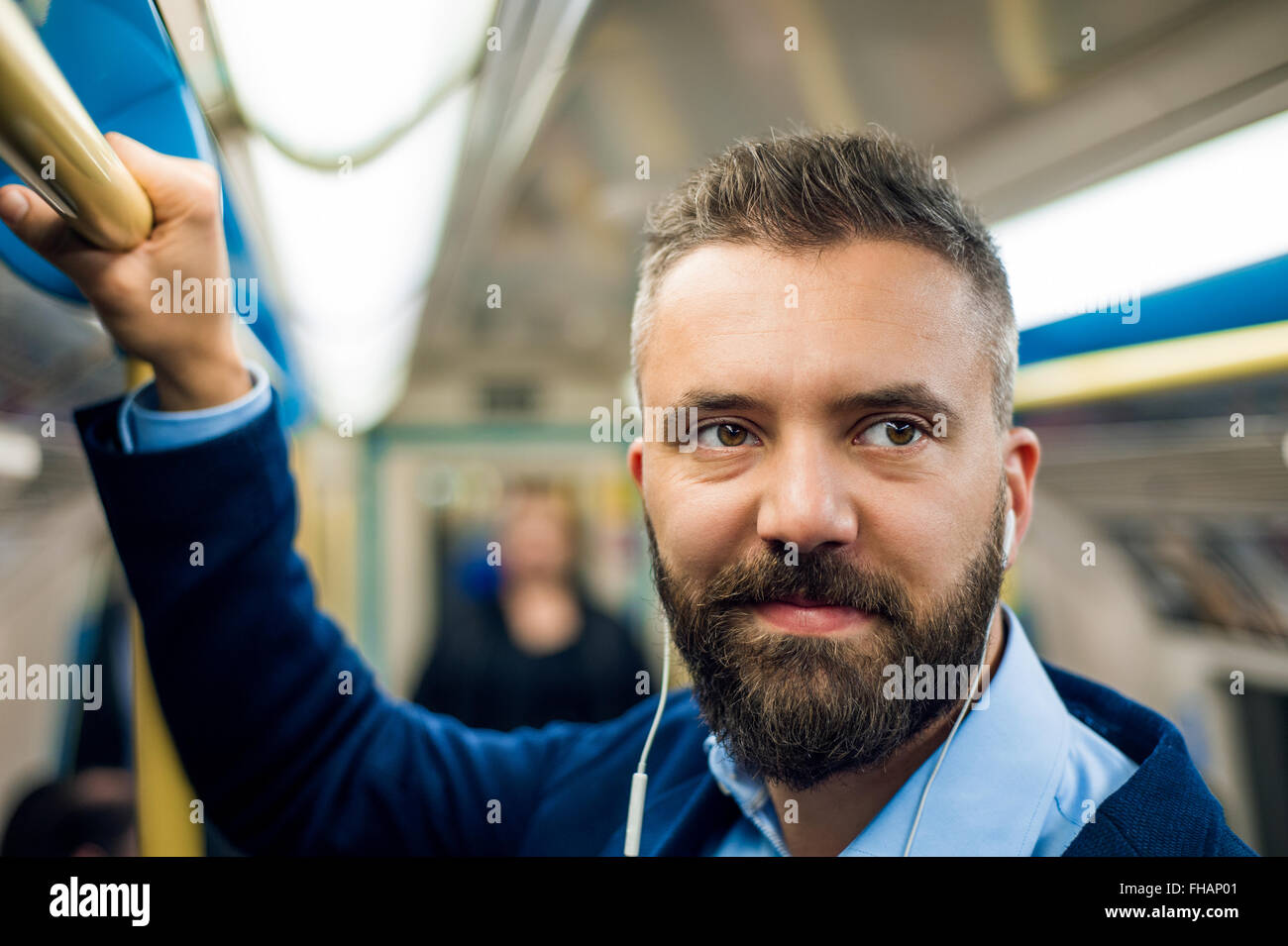 Detail of businessman travelling to work. Inside underground wag - Stock Image