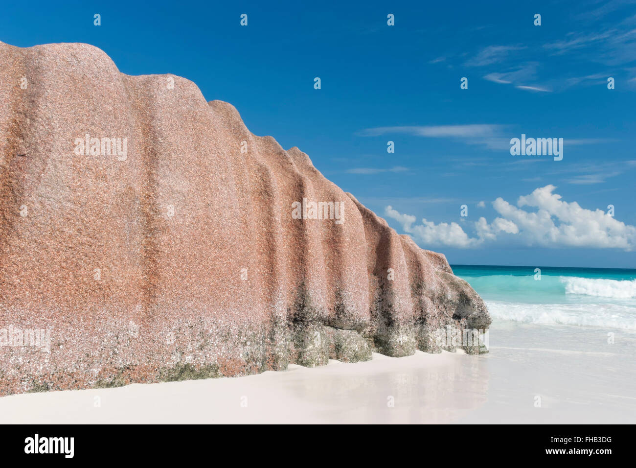 Large granite rock on tropical island white sand beach in Seychelles, Indian Ocean - Stock Image