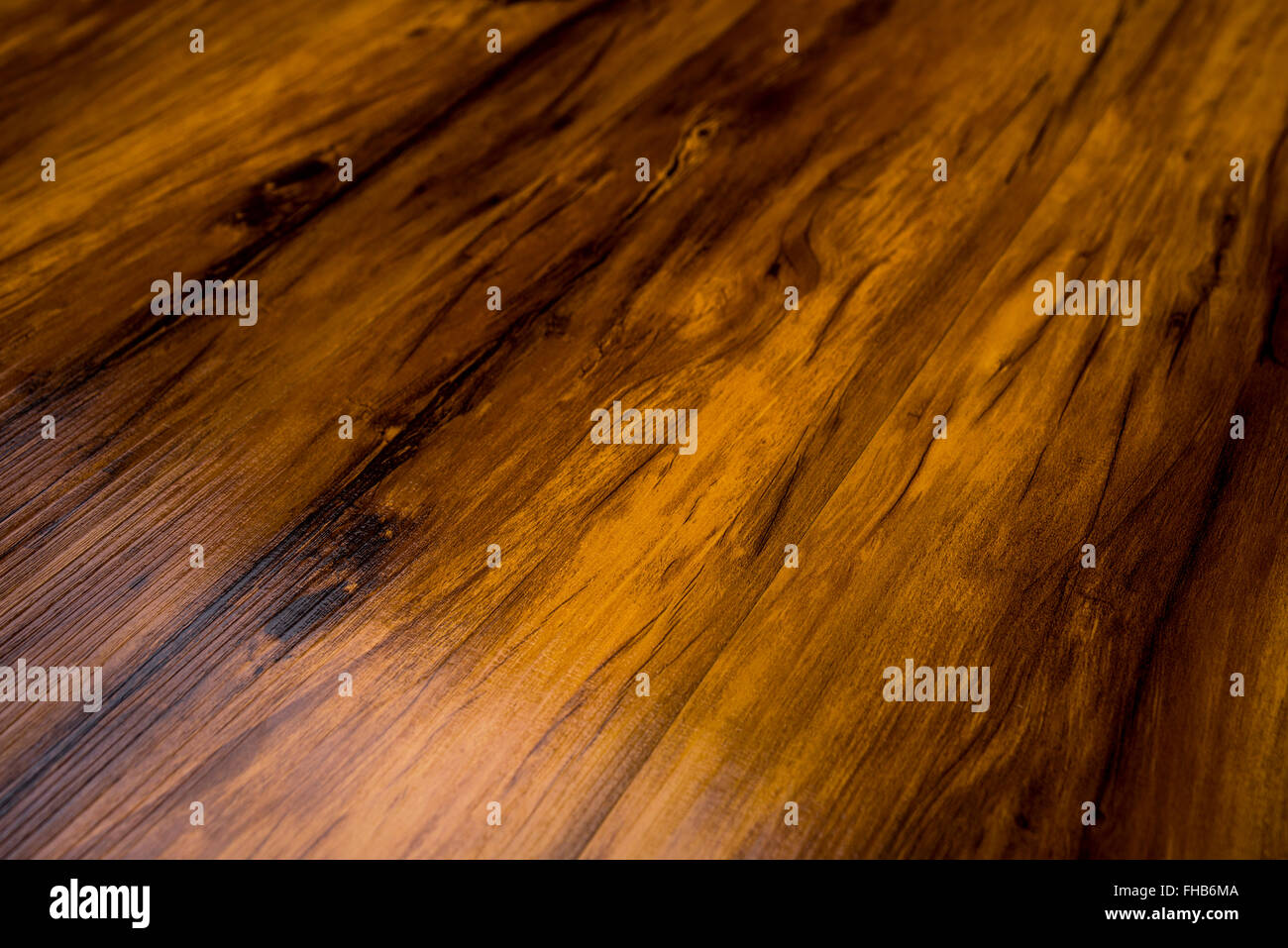 polished wooden flooring showing texture and grain - Stock Image