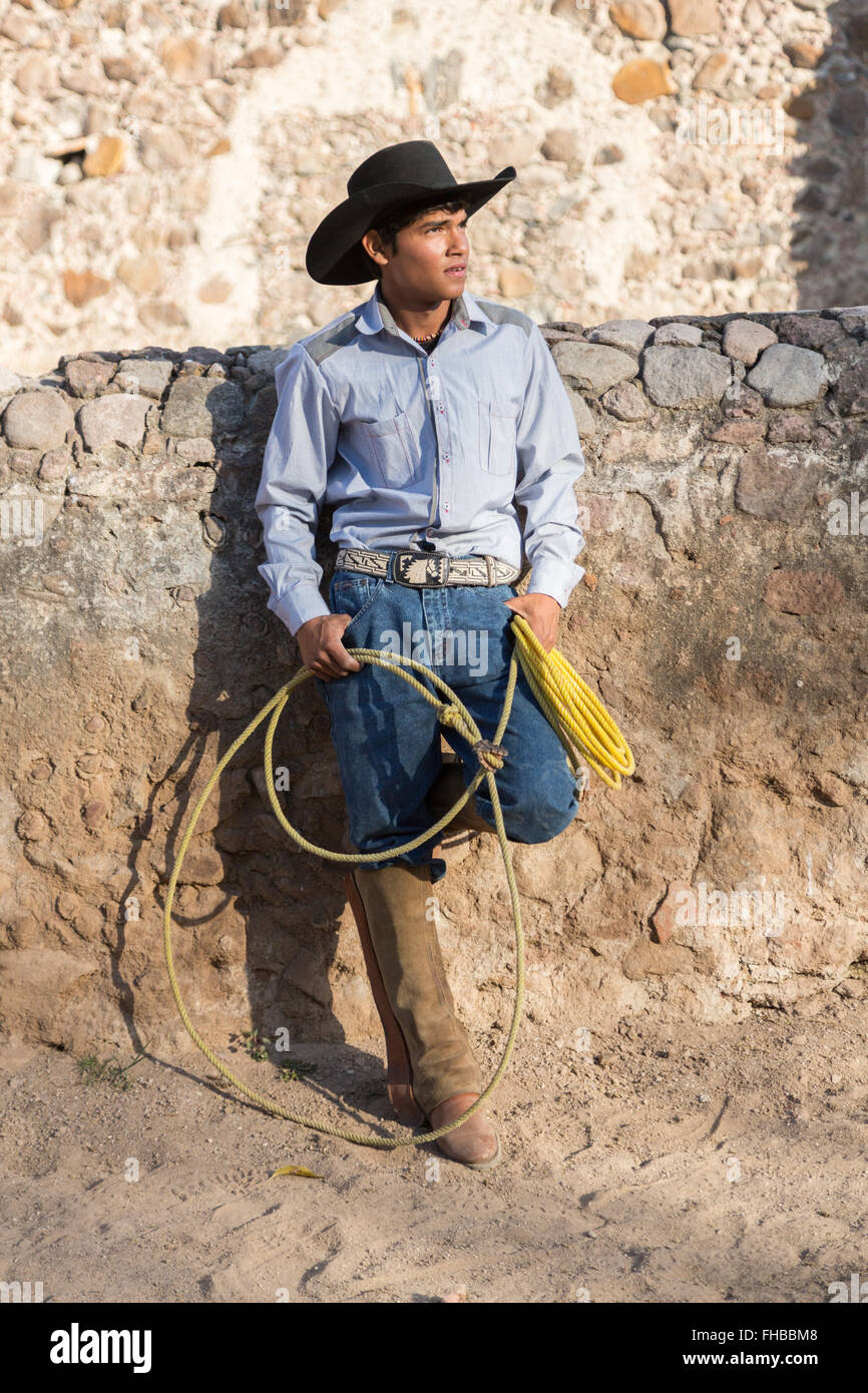 A Mexican charro or cowboy poses in cowboy hat and lasso at a hacienda ranch  in Alcocer 7878d41802c4