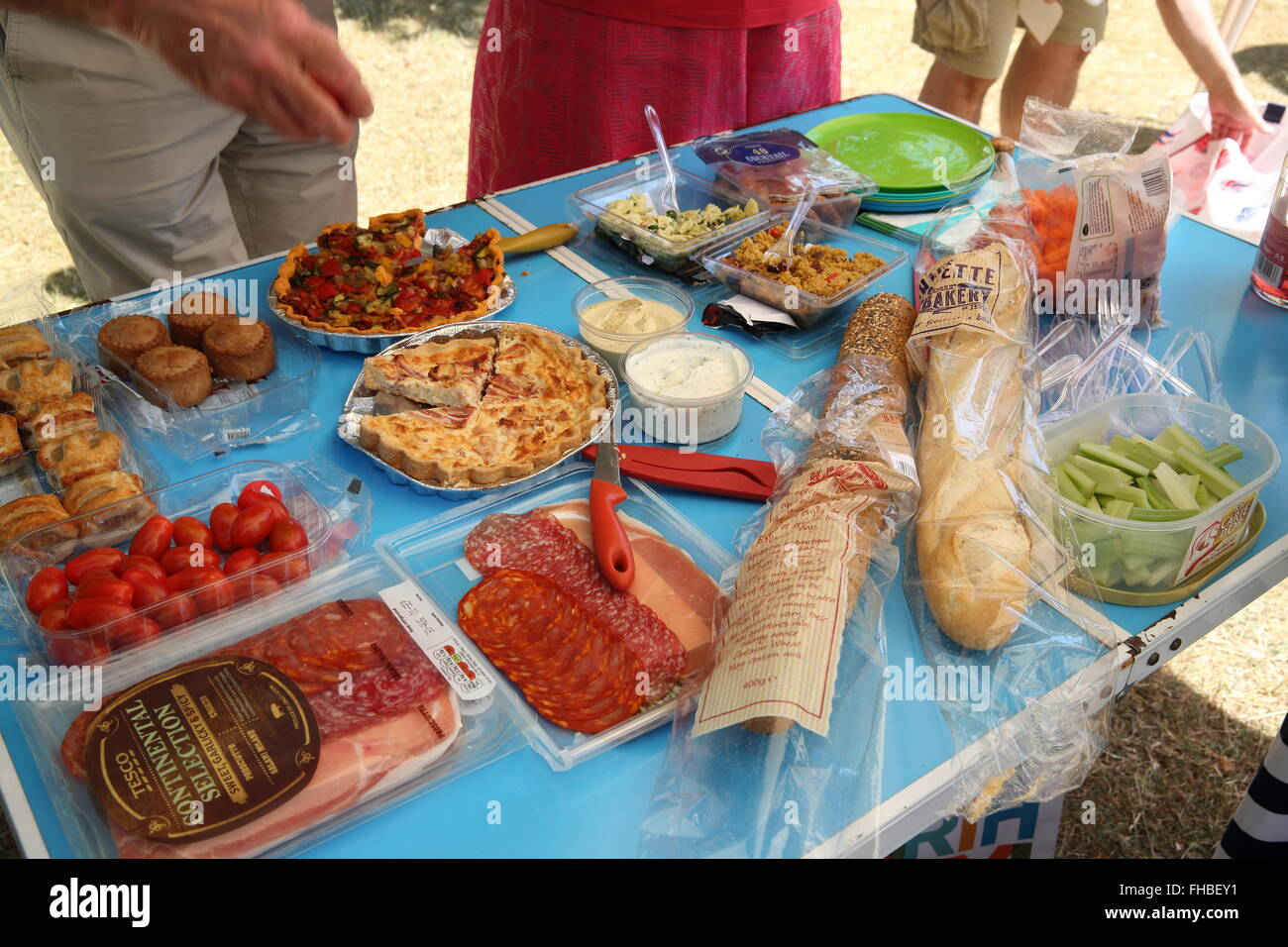 A summer picnic table for a family party in Bushey Park, in Middlesex, England, UK Stock Photo