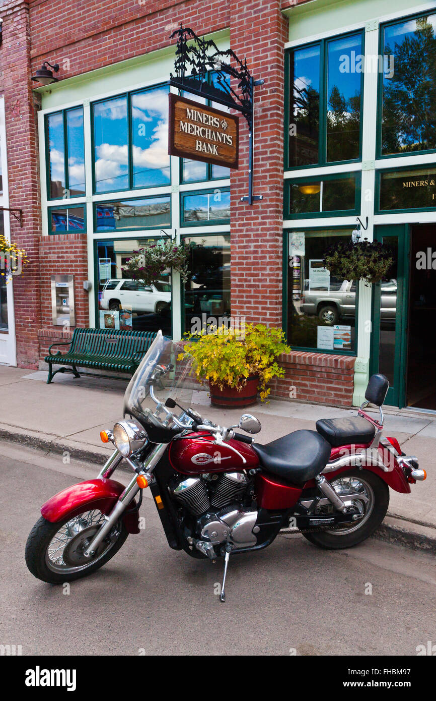 A MOTORCYCLE parked on the main street of CREEDE COLORADO, a silver mining town dating back to the mid 1800's - Stock Image