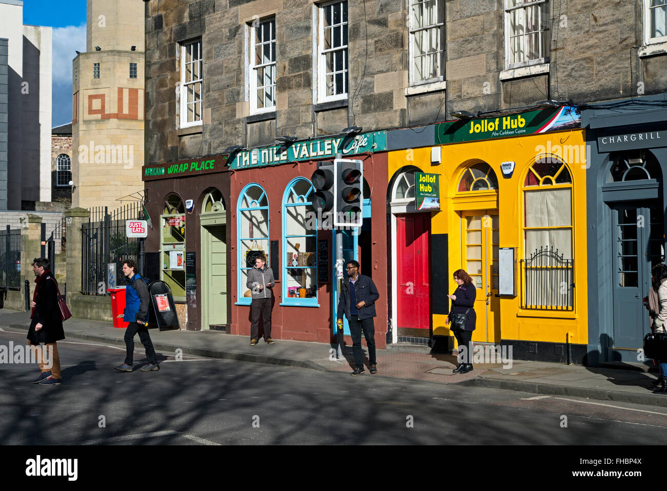 A row of brightly coloured cafés beside the Edinburgh Central Mosque in the University district. Stock Photo