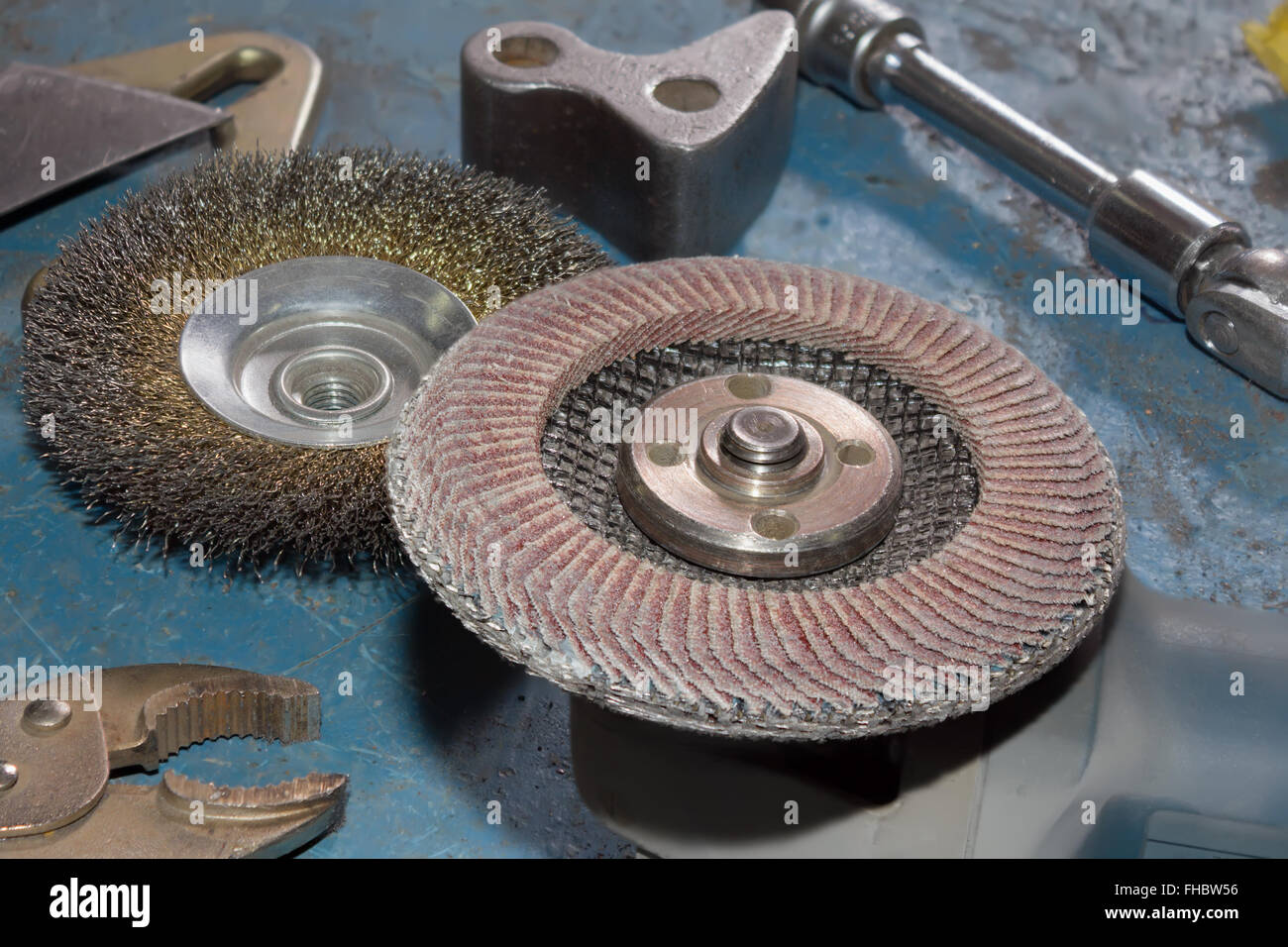 Angle grinder with wire brush for mechanical cleaning of metal and abrasive disk for grinder. - Stock Image