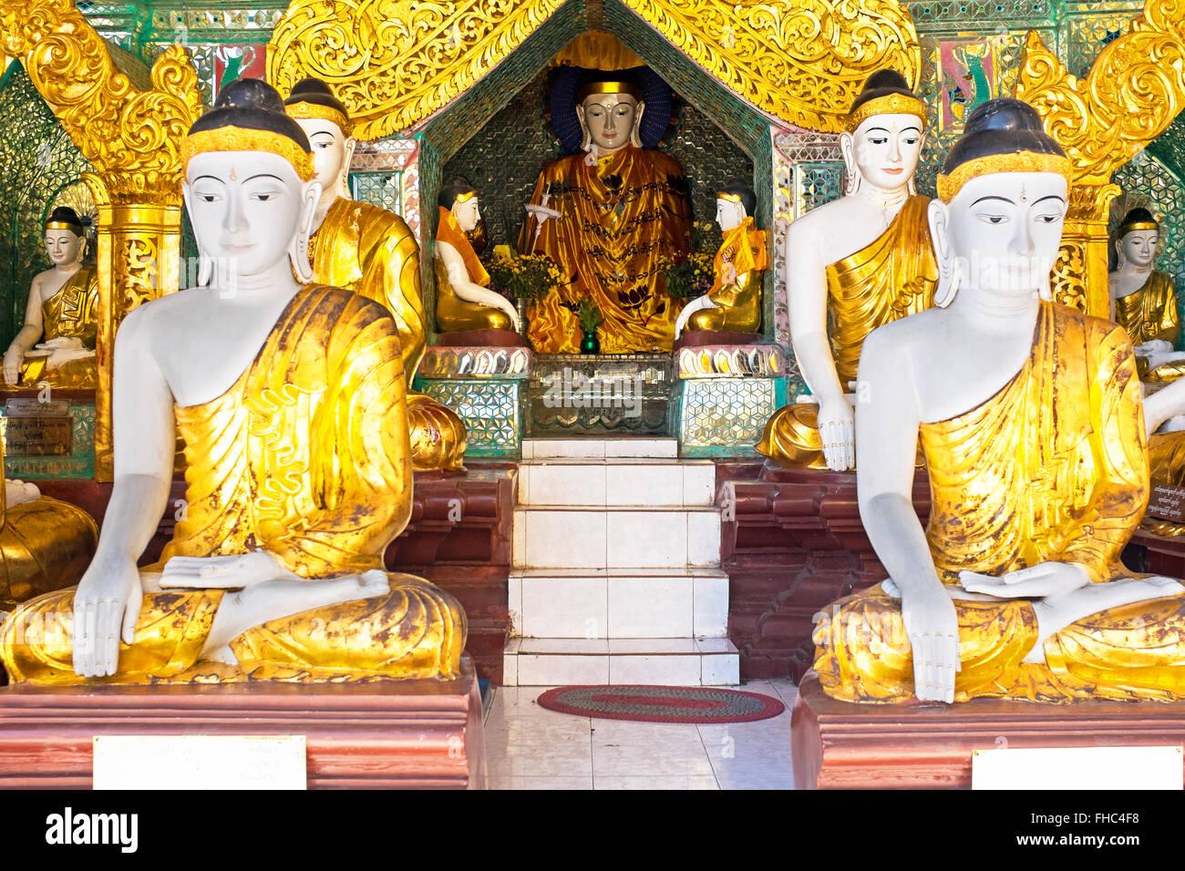 Buddha statues in the Shwedagon pagode in Yangon Myanmar Stock Photo