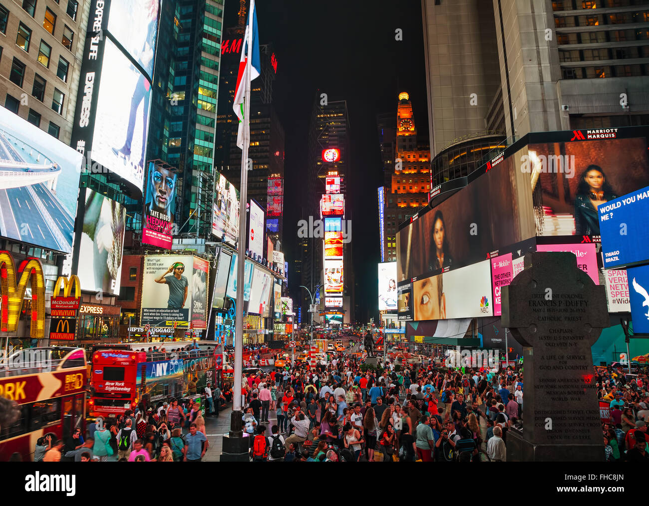 NEW YORK CITY - SEPTEMBER 05: Times square with people in the night on September 5, 2015 in New York City. - Stock Image
