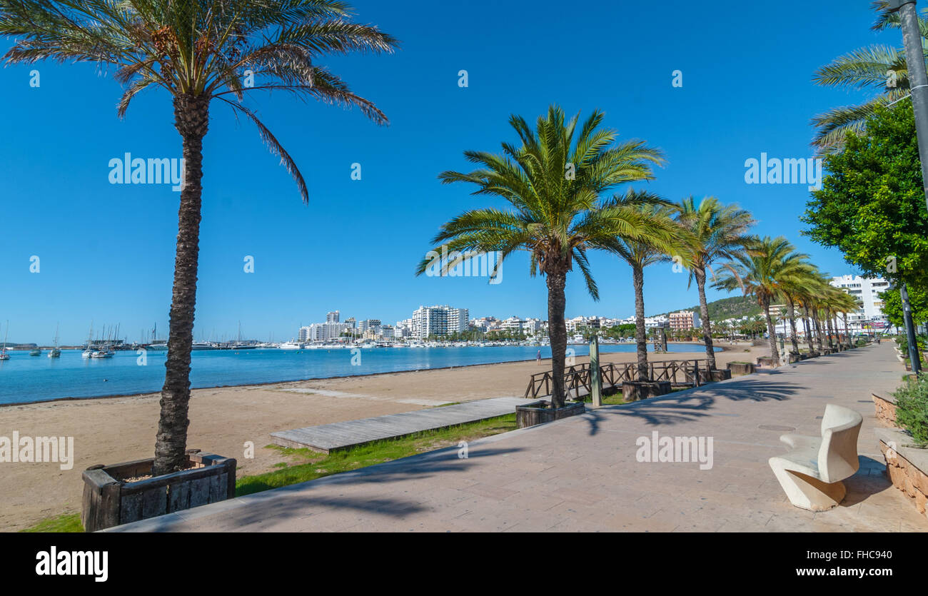 Mid morning sun on the waterfront.  Warm sunny day along the beach in Ibiza, St Antoni de Portmany Balearic Islands, - Stock Image