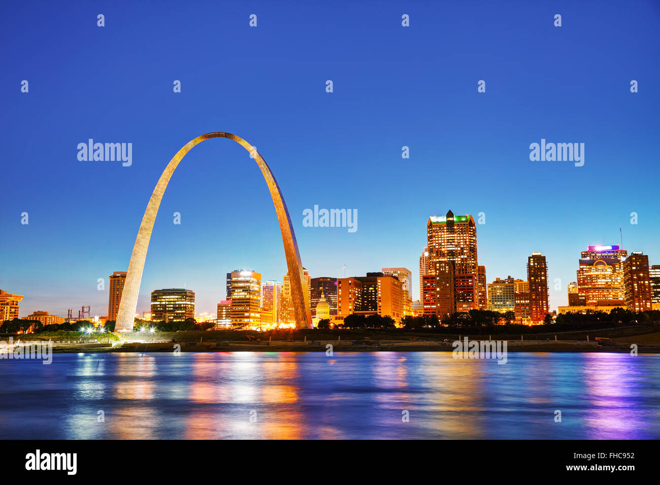 Downtown St Louis, MO with the Old Courthouse and the Gateway Arch at sunset - Stock Image