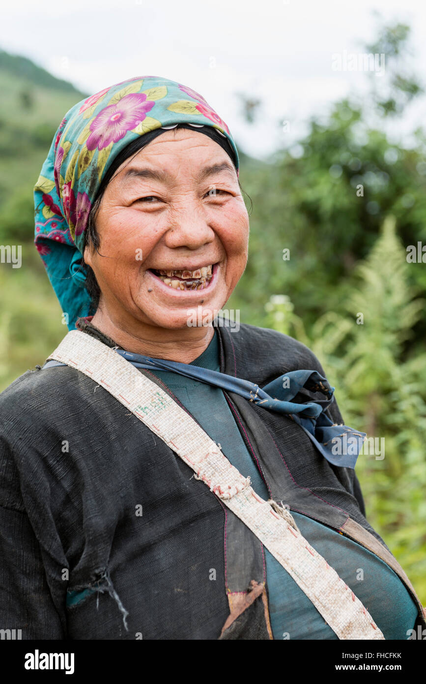 Akha woman with teeth colored from betel nuts, Burma - Stock Image