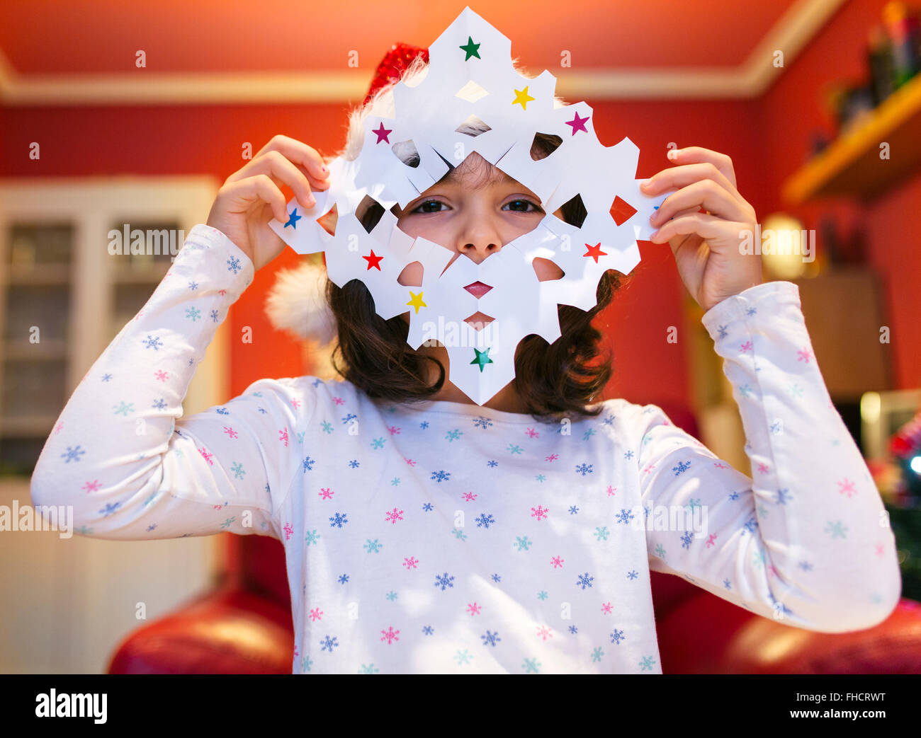 Little girl with tinkered Christmas decoration - Stock Image