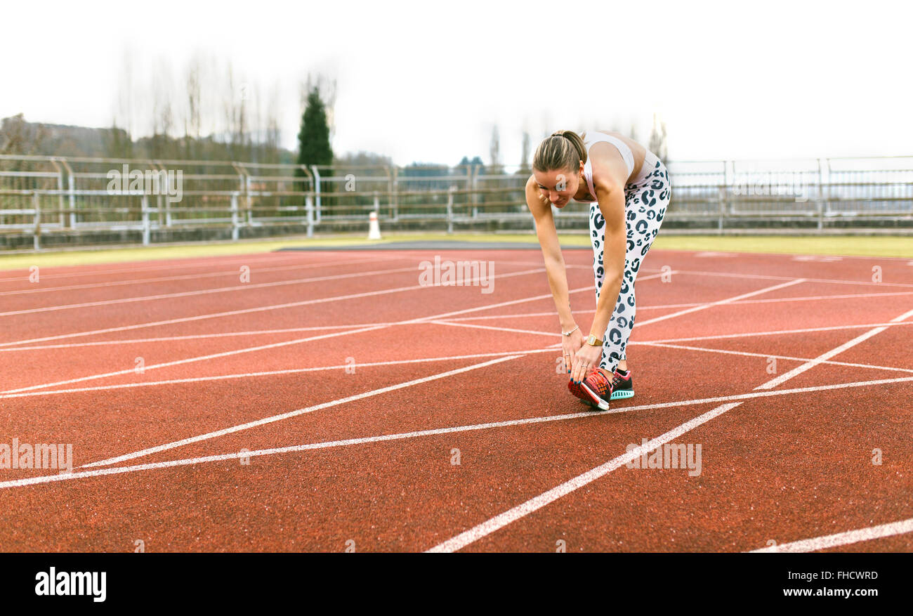 Athlete woman doing stretching - Stock Image