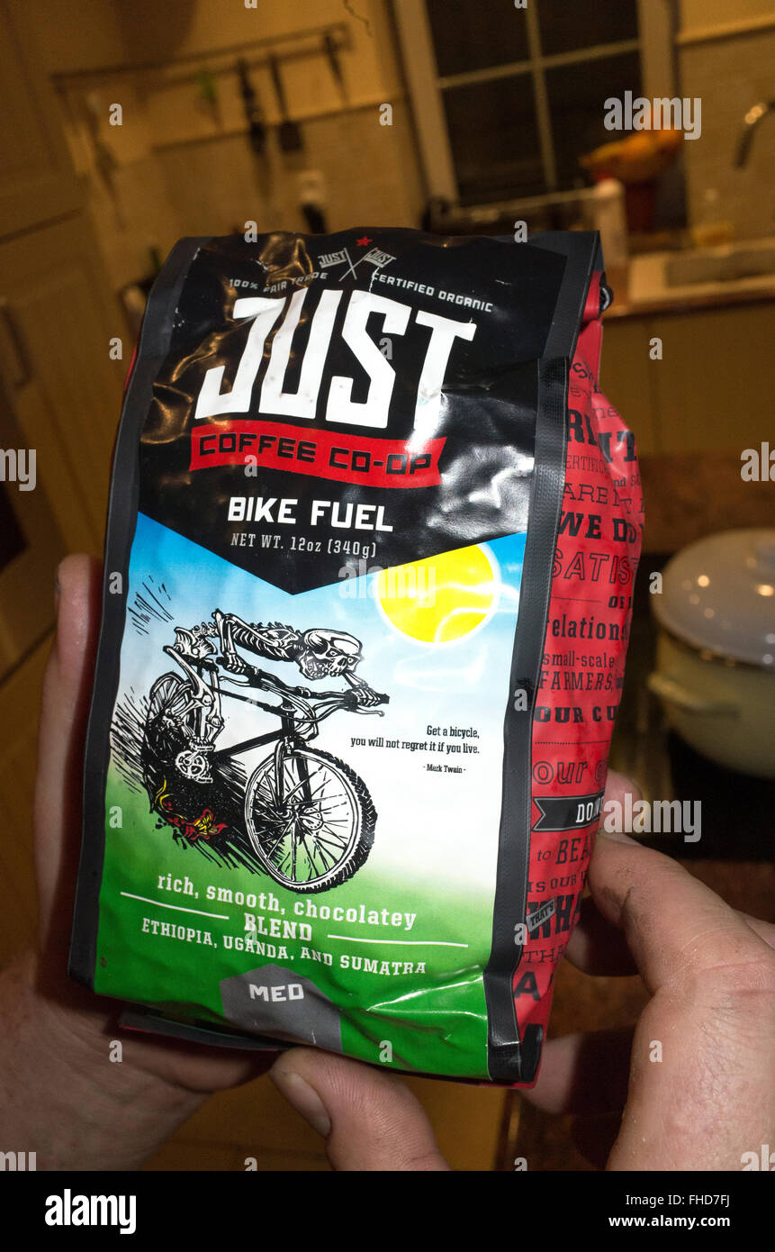 Bag of Fair Trade organic Bike Fuel coffee with a speedy skeleton riding bicycle from Just Coffee Co-op. Zawady - Stock Image