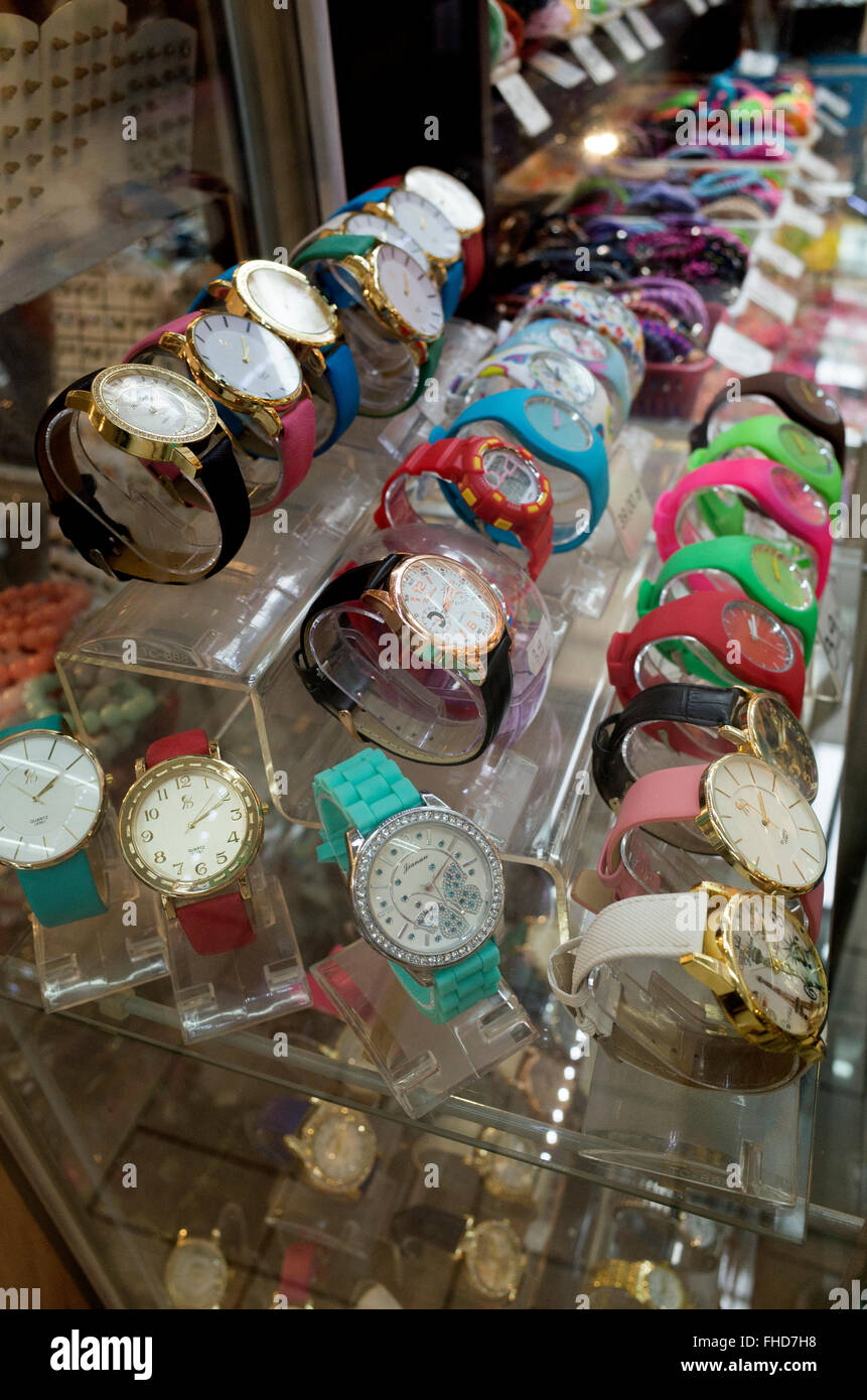 Counter top display of bling style decorative wrist watches with florescent colors. Tomaszow Mazowiecki Central - Stock Image