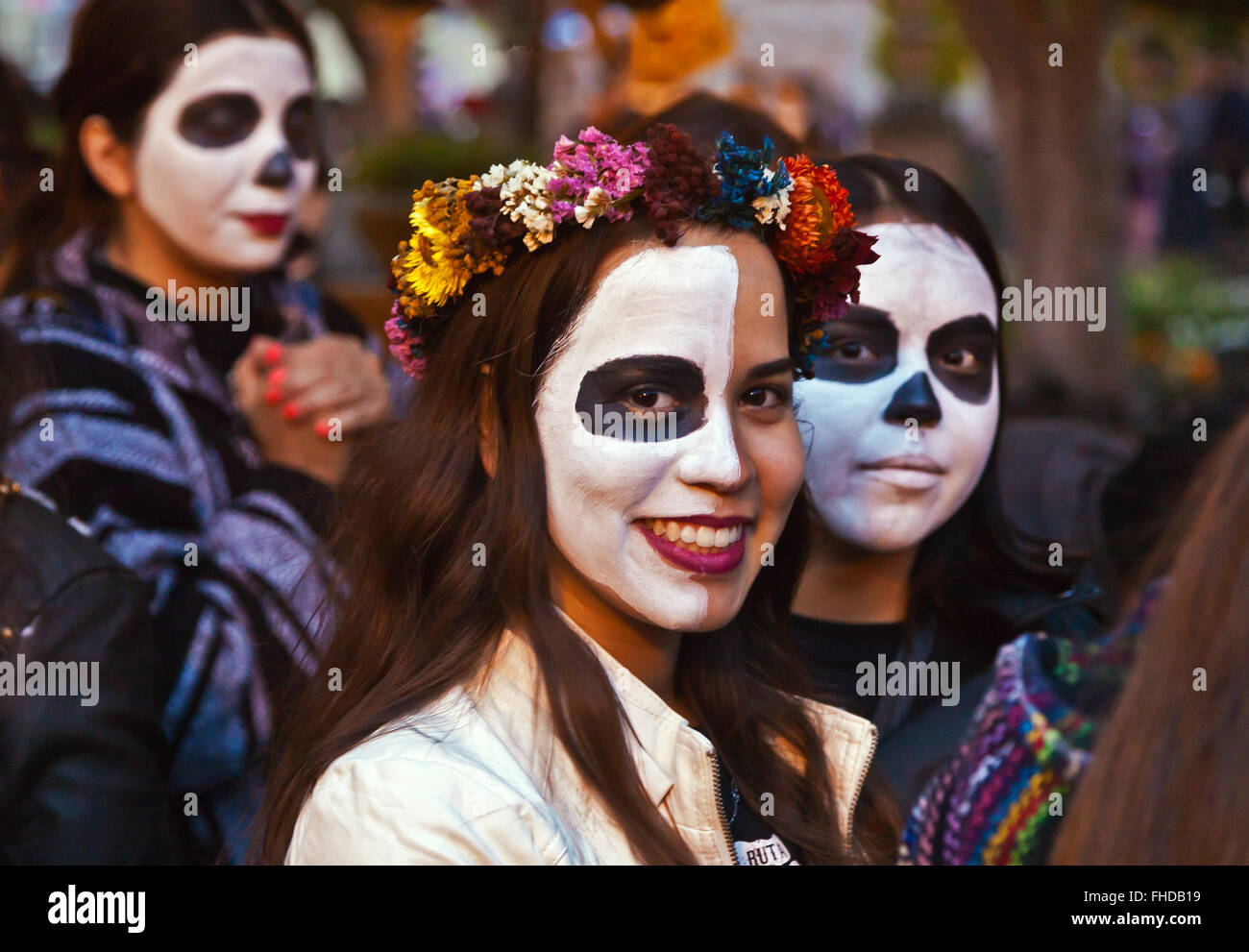 Faces are painted like skulls as people transform themselves into CATRINAS during DAY OF THE DEAD  -  SAN MIGUEL - Stock Image