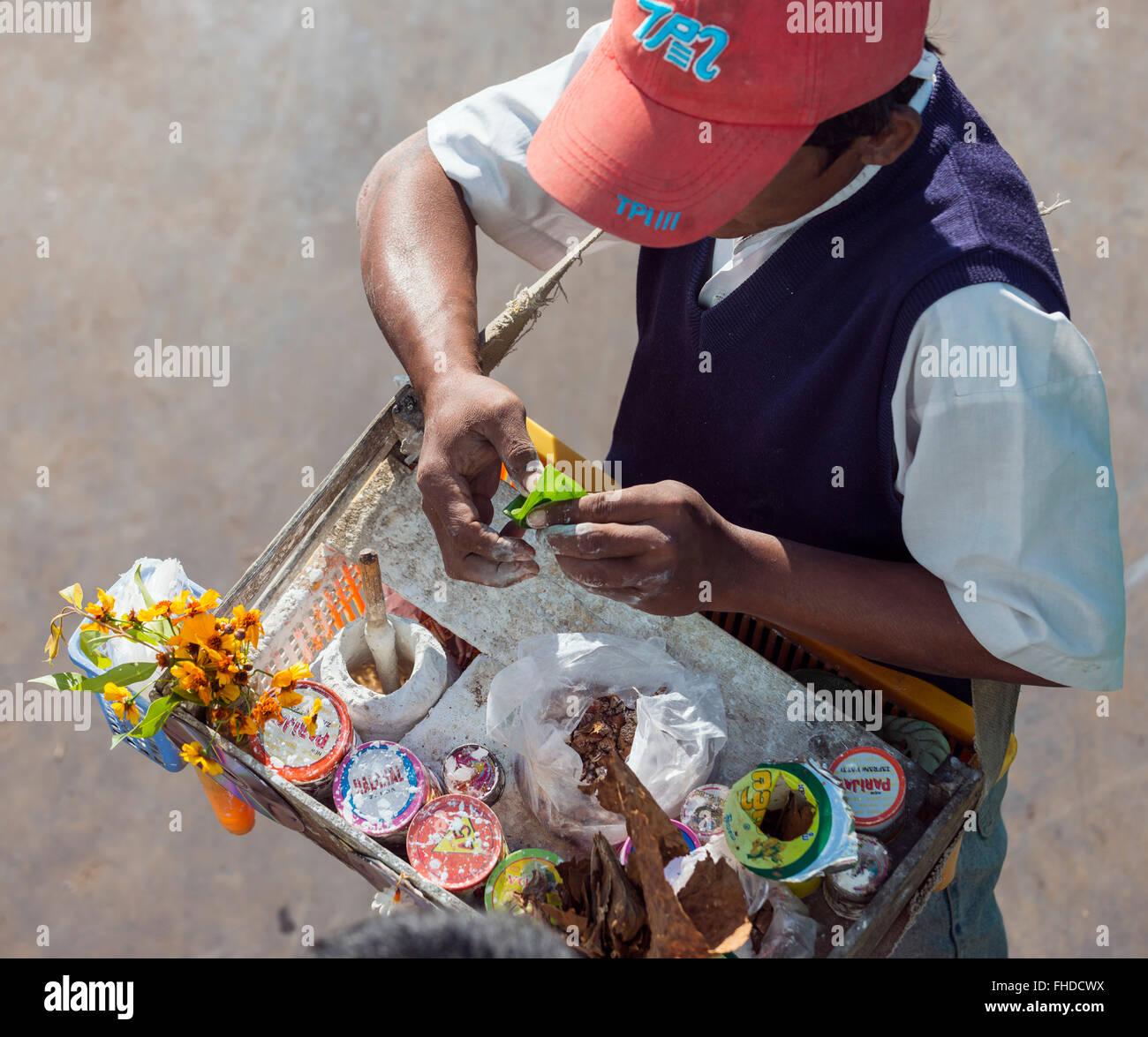 Salesman of areca nuts in betel leaves, Burma - Stock Image