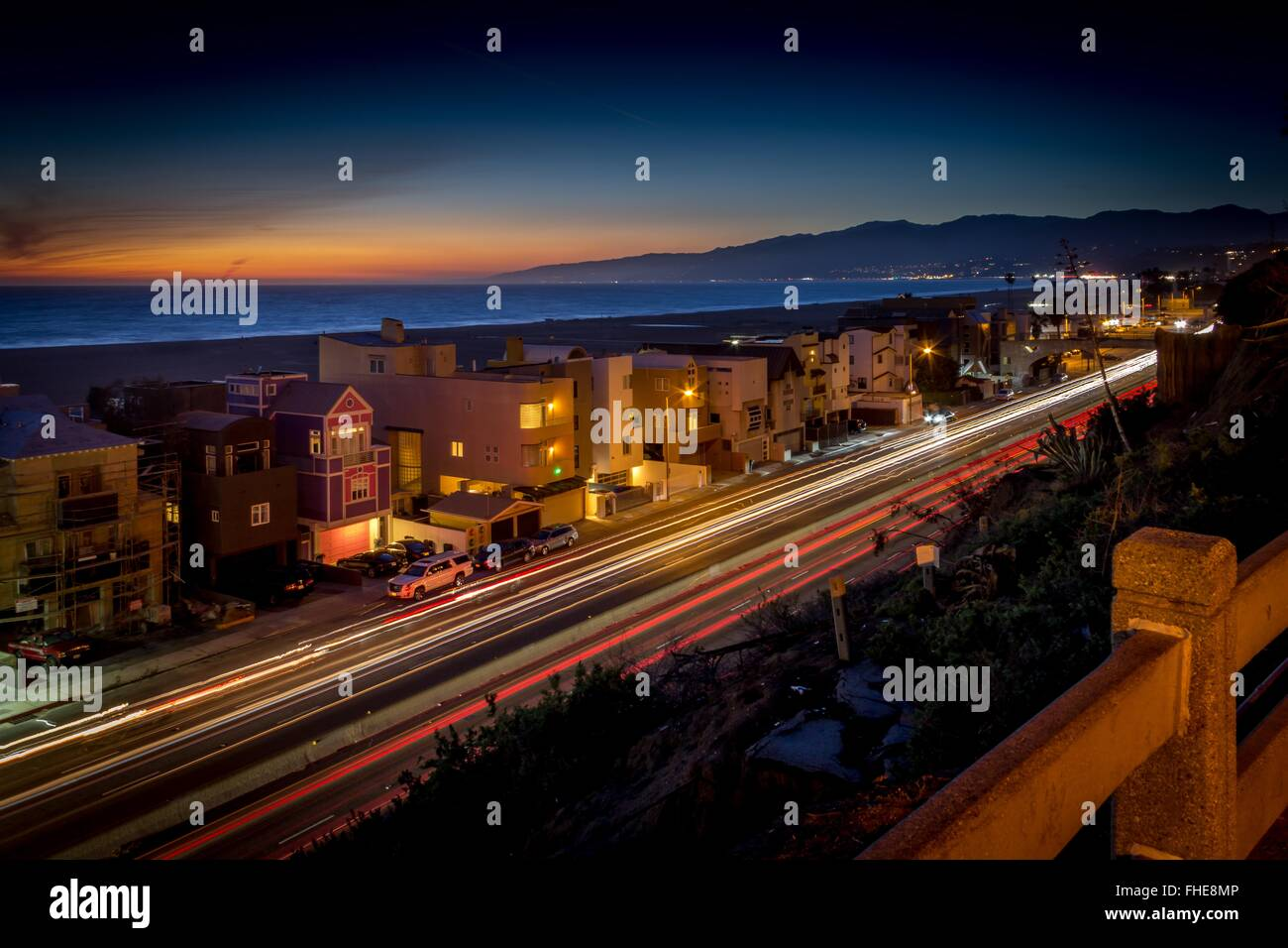 PCH, Pacific Coast Highway, Santa Monica - at sunset looking North to Malibu - Stock Image