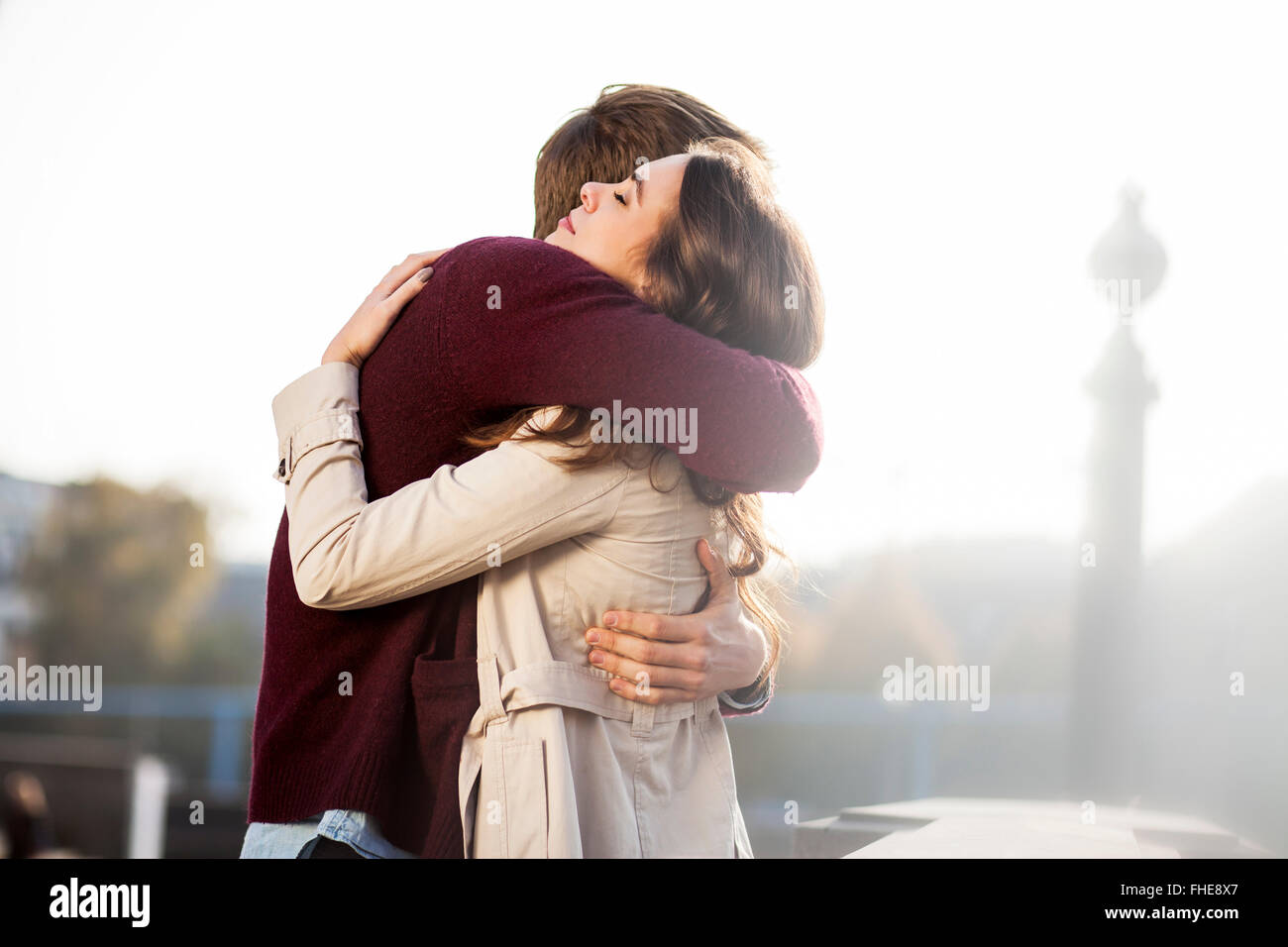 Germany, Berlin, young couple hugging Stock Photo