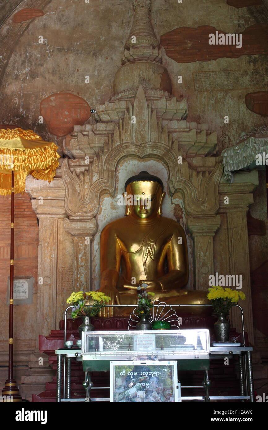 old golden Buddha statue in pagoda temple in Bagan,Myanmar Stock Photo