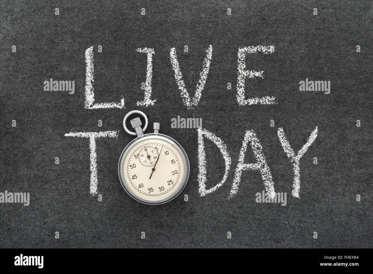 live today concept handwritten on chalkboard with vintage precise stopwatch used instead of O - Stock Image