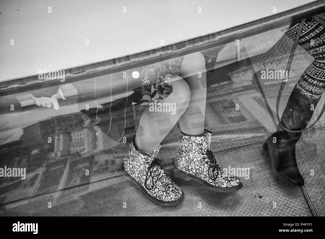 View through glass to peoples feet - Stock Image