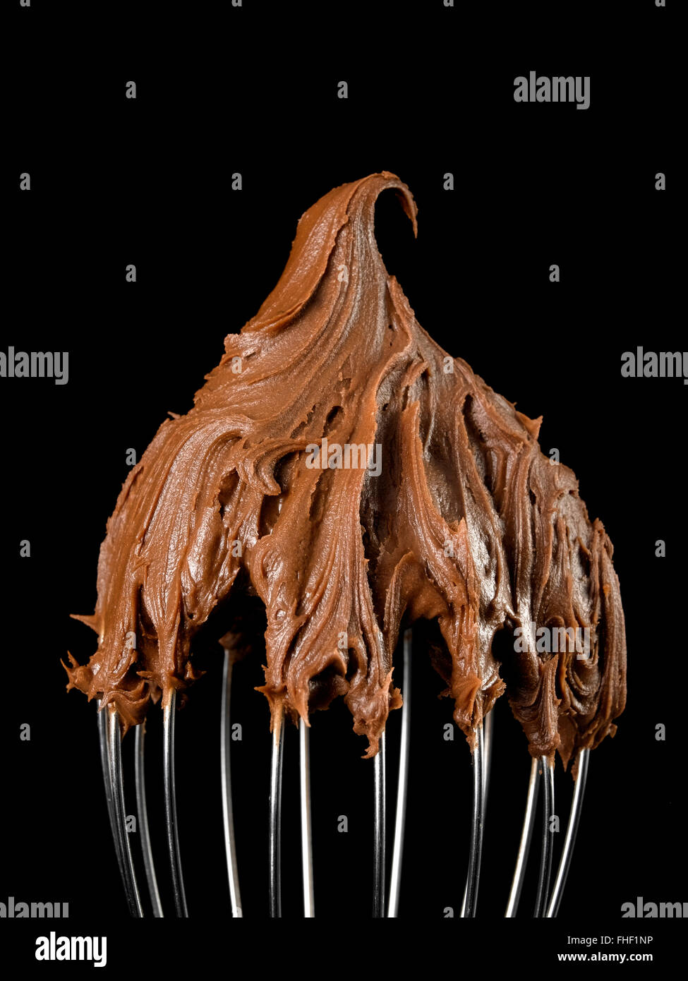 Kitchen whisk with Chocolate - Stock Image