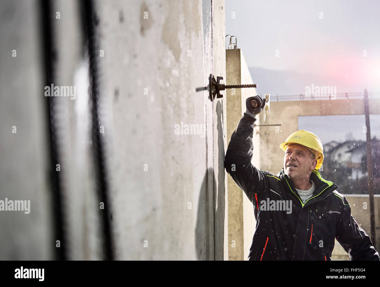 Construction worker at building site, construction, removal of formwork, Innsbruck Land, Tyrol, Austria Stock Photo
