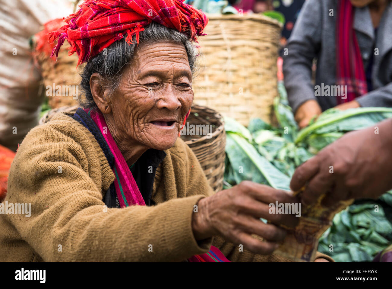 Smiling woman, saleswoman from Pao hilltribe or mountain people, market, Kalaw, Shan State, Myanmar, Burma - Stock Image