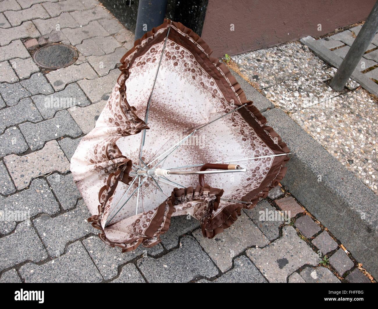 Broken umbrella - Stock Image