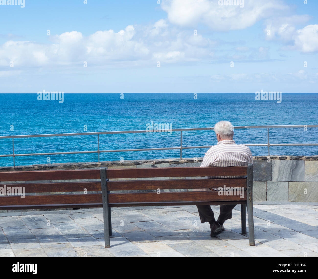 [Image: old-man-sitting-on-bench-looking-out-to-...FHFH3X.jpg]