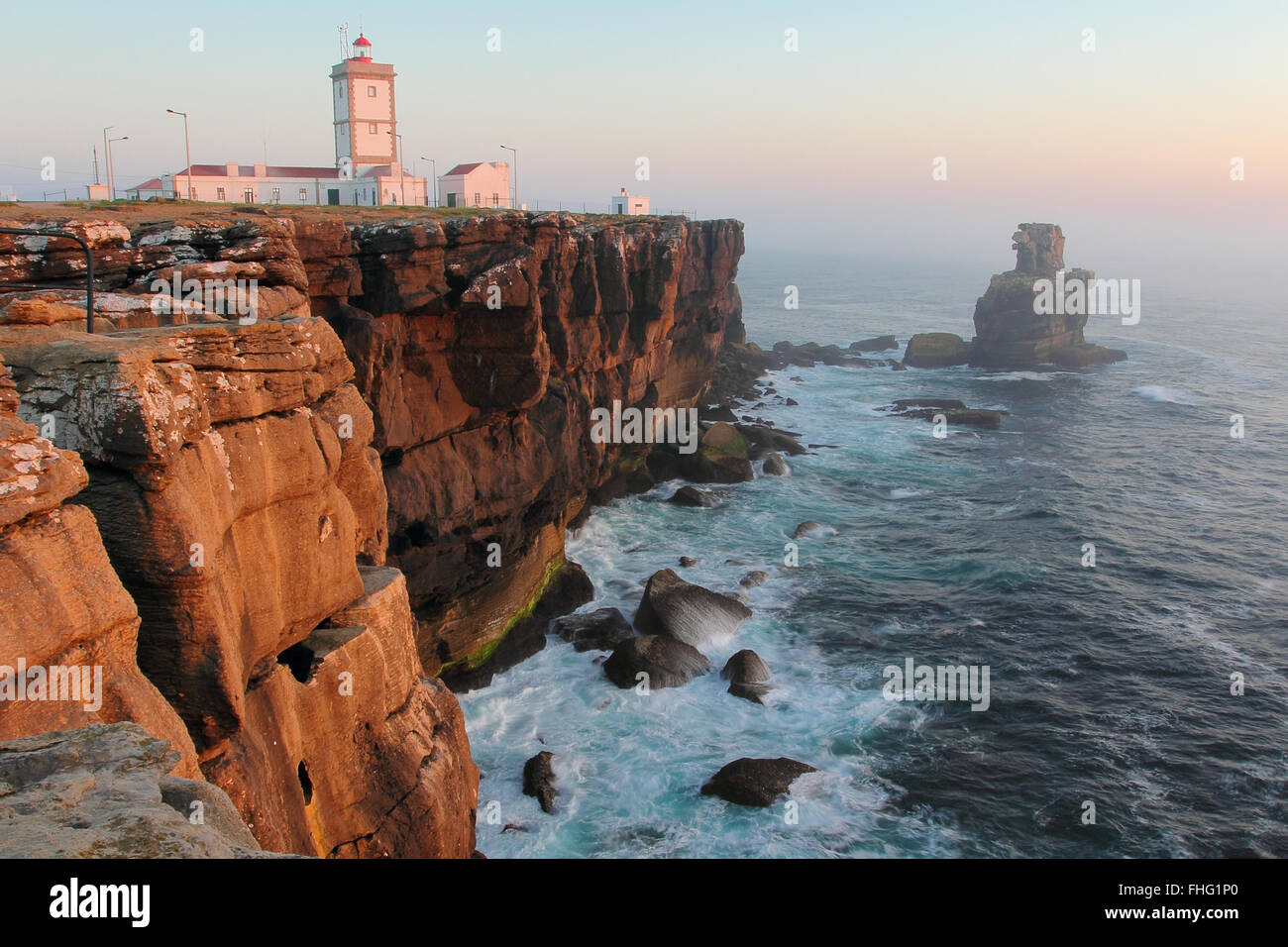 Cabo Carvoeiro lighthouse in sunset light . South Portugal Stock Photo