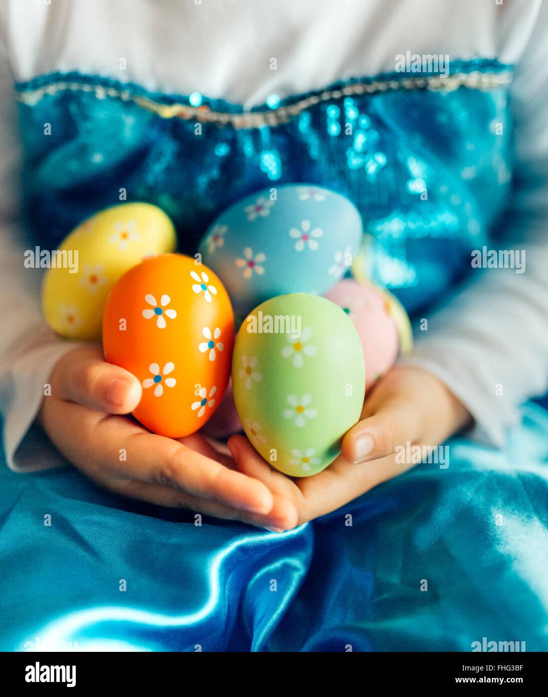 Little girl's hands holding Easter eggs - Stock Image