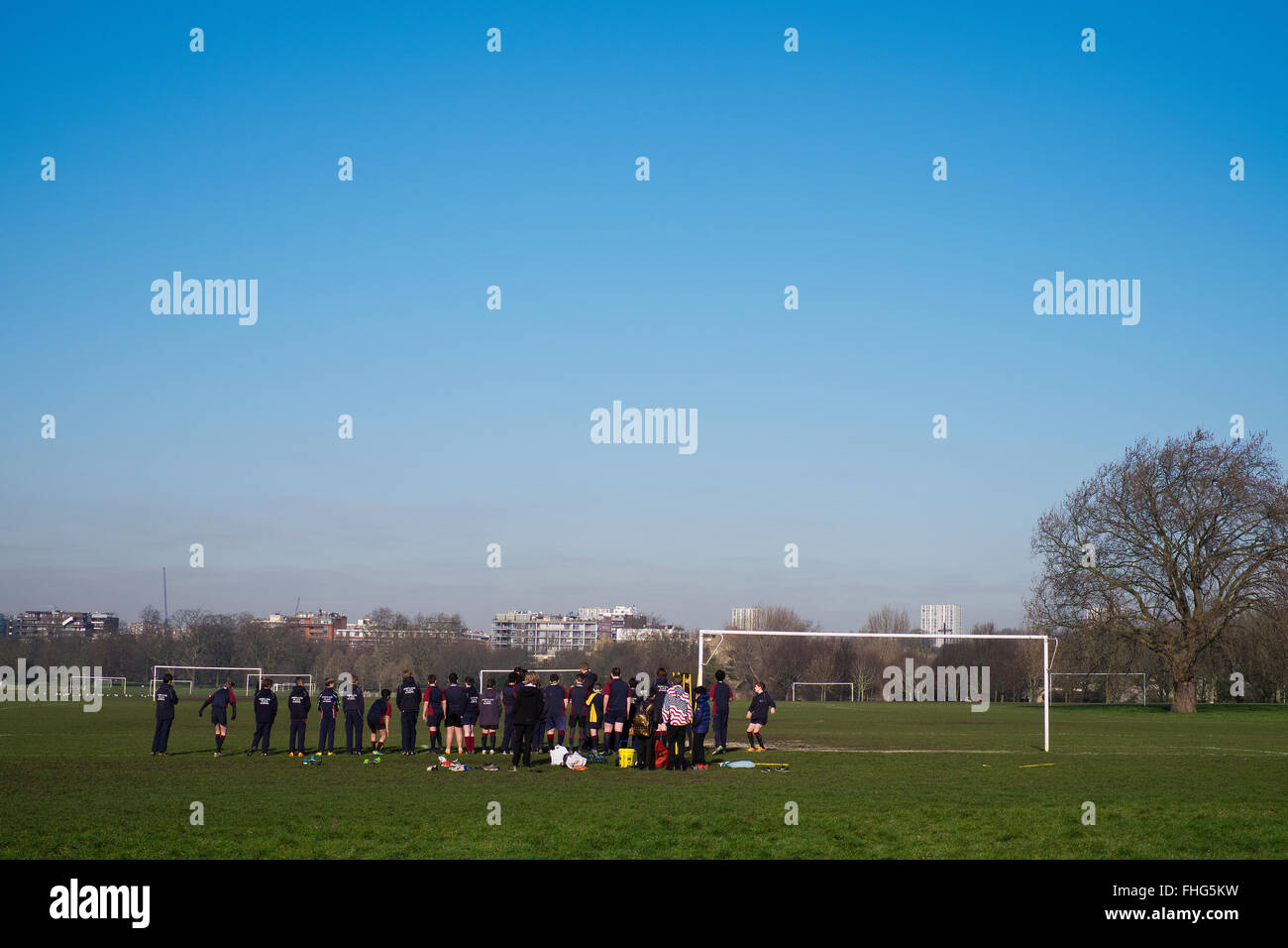 Pupils from a London Private school partake in physical activity in Regents Park in winter - Stock Image