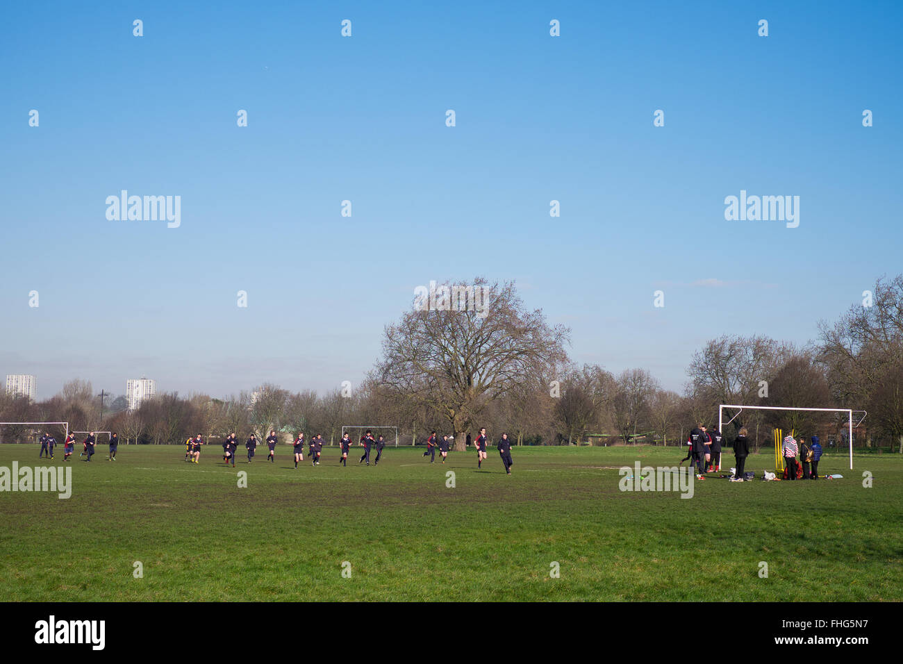 Pupils from a private school partake in physical trining in Regents Park in winter London - Stock Image