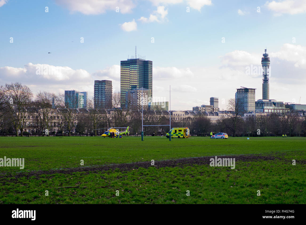 Air Ambulance lands in Regents Park in winter London England - Stock Image