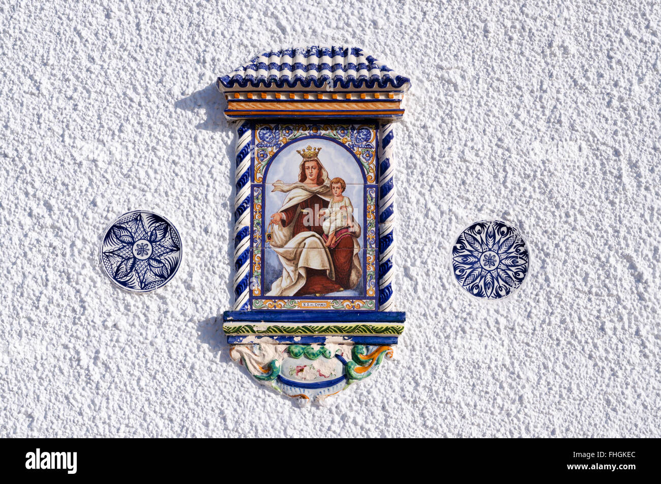 Decorative Christian Religion Wall Plaques On A White Washed House Wall    Depicting The Virgin