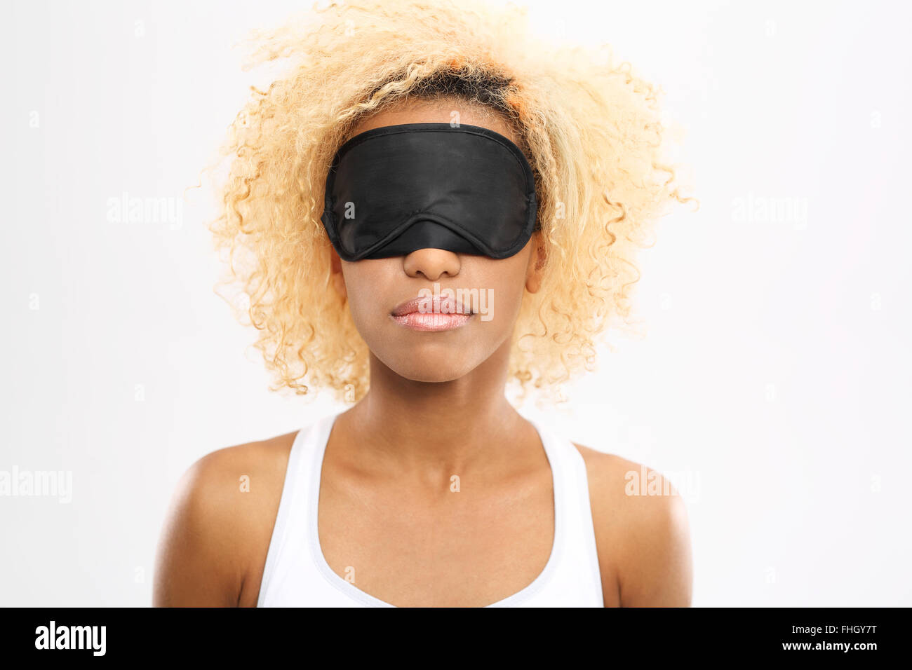 Restful sleep.. Young woman with eyes blindfolded band on eyes - Stock Image