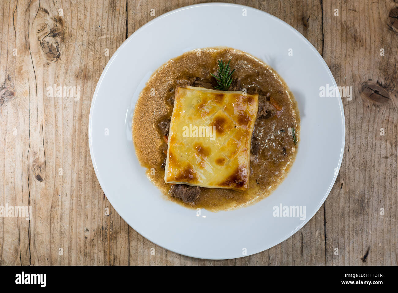 Steak and kidney pie from above. French restaurant prepared cuisine influenced by a traditional English recipe, - Stock Image