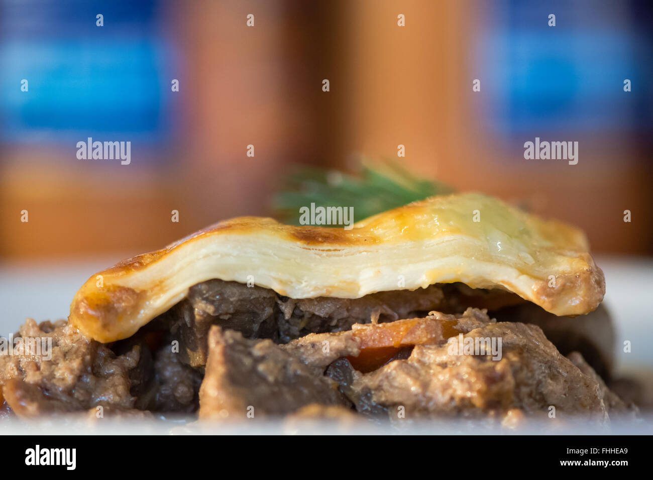 Steak and kidney pie. French restaurant prepared cuisine influenced by a traditional English recipe, presented on - Stock Image