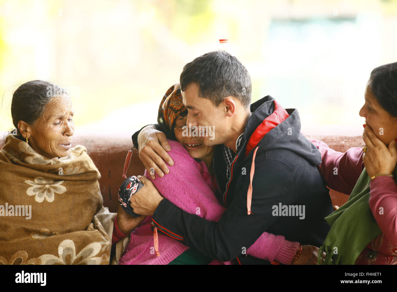 Pokhara. 25th Feb, 2016. Relatives of the victims of an aircraft crash cry at Pokhara Airport in Nepal, Feb. 25, - Stock Image