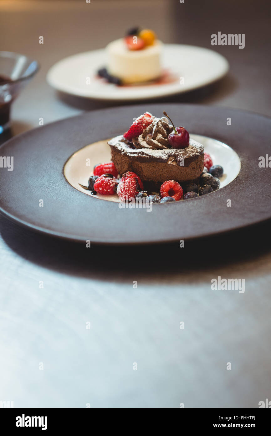 Plates of dessert at the order station - Stock Image