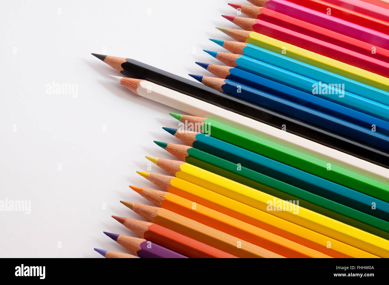 Black and white pencils sticking out from coloured pencils. - Stock Image