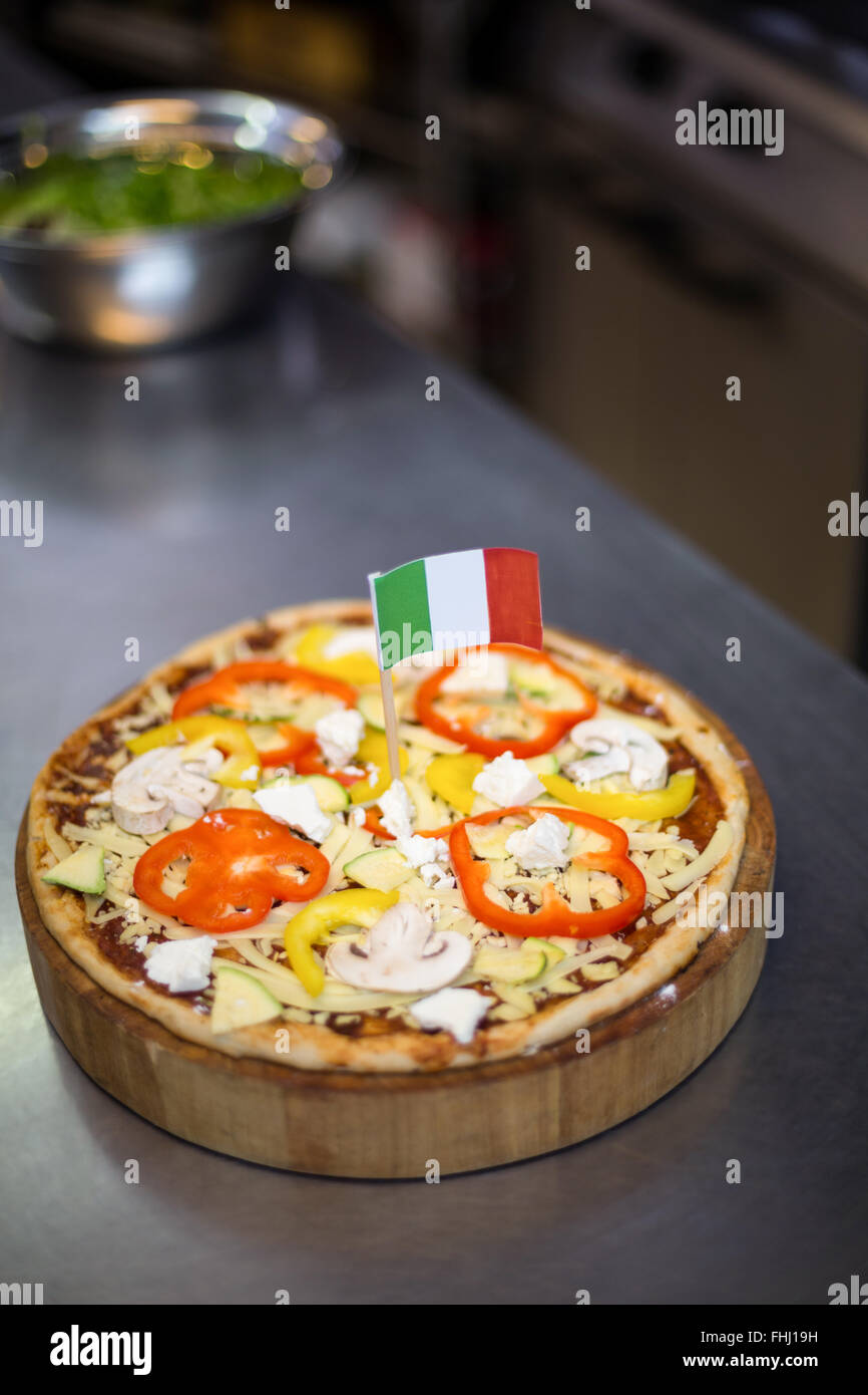 Pizza with italian flag - Stock Image