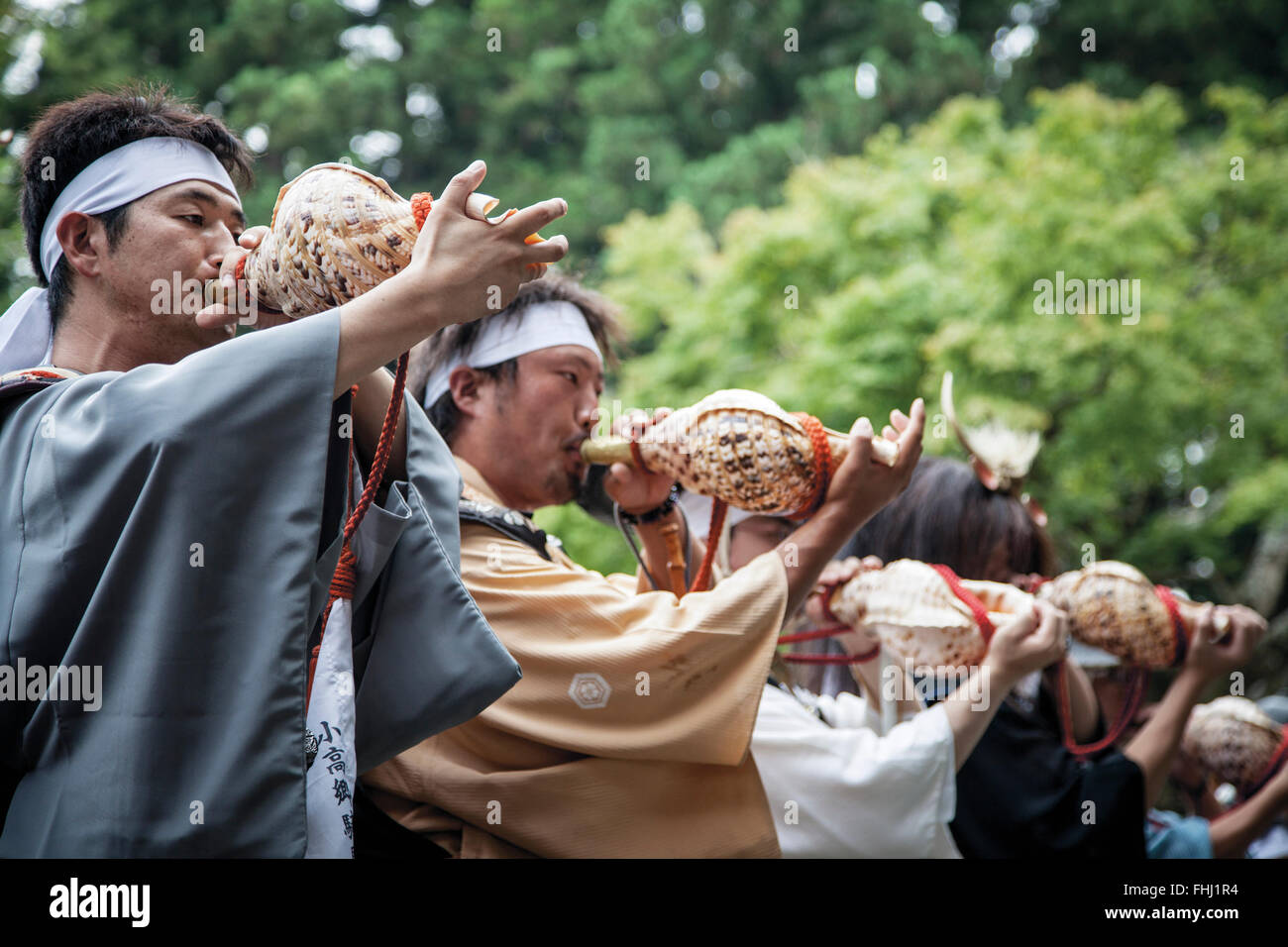 Japan / Fukushima  -   In 2011 the conch shell was blown upside down to offer prayers of repose for the departed - Stock Image